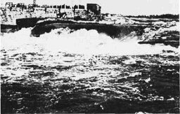 Water flowing over Koochiching Falls before dam was in place